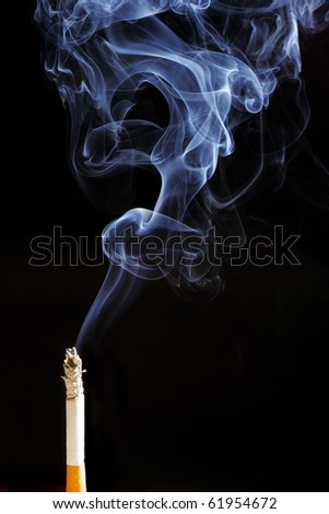 Smoking cigarette. Isolated on black. - stock photo