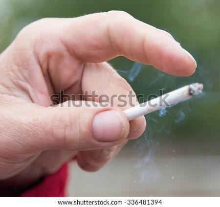 smoking cigarettes - stock photo