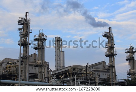 smoking coal used power station in china hong kong with the beautiful blue sky horizontal background - stock photo