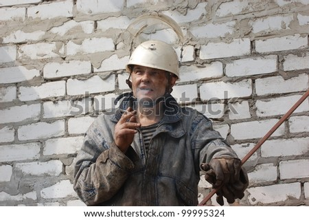 Smoking Construction Worker - stock photo
