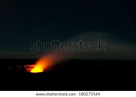 Smoking Crater of Halemaumau Kilauea Volcano in Hawaii Volcanoes National Park on Big Island at night - stock photo