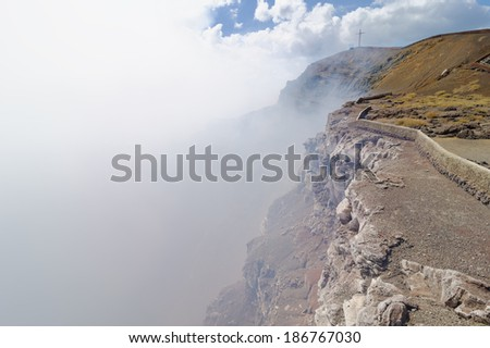 Smoking crater of the volcano Masaya, Nicaragua - stock photo