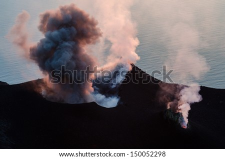 Smoking erupting volcano on Stromboli island, Sicily, Italy - stock photo