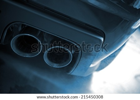 Smoking Exhaust Closeup. Modern Car Exhaust. Ecology in Transportation Concept. - stock photo