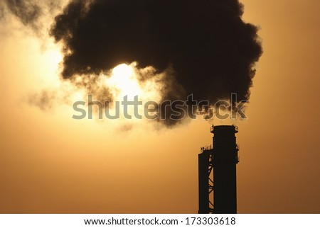 smoking factory chimney in the morning light