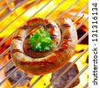 Smoking Flaming Rolled Sausage in a close up shot - stock photo