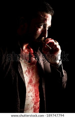 smoking gangster with gun - stock photo
