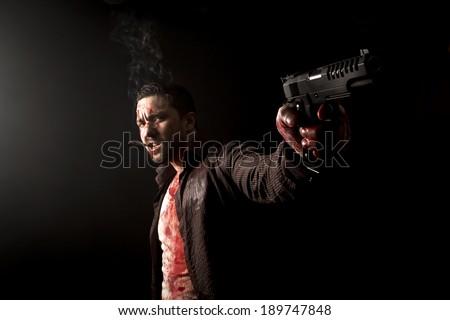 smoking gangster with gun - stock photo