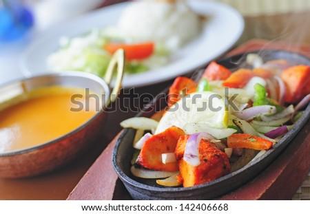 Smoking hot Chicken Tikka Sizlar - stock photo