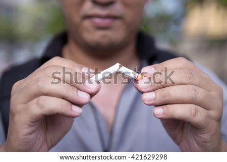 Smoking is a health hazard and peers. - stock photo