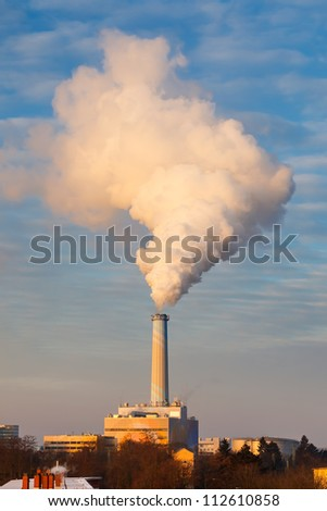 Smoking pipe of power station - stock photo
