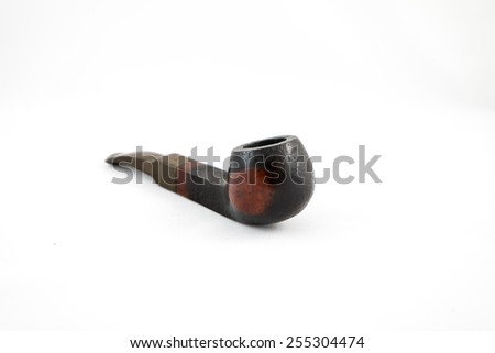 Smoking pipe - wooden, dark brown color on the isolated white background - stock photo