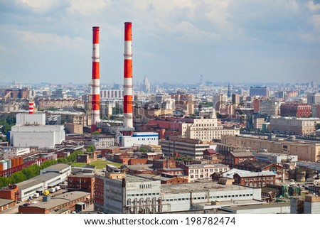 Smoking pipes in the city. Industrial zone in a residential area - stock photo
