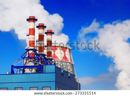 Smoking pipes of gas-turbine plant against blue sky