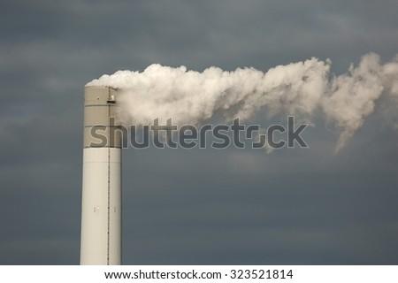 Smoking power plant chimney closeup - stock photo