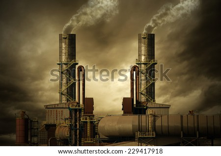 Smoking stacks of the Factory - stock photo