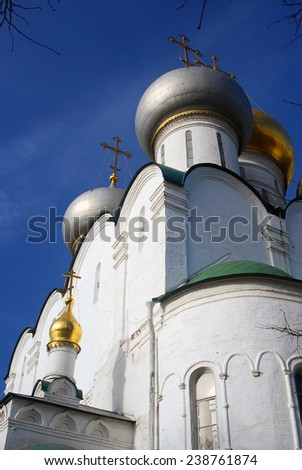 Smolensky cathedral. Blue sky background. Novodevichy convent in Moscow. Popular touristic lanmdark. UNESCO World Heritage Site.
