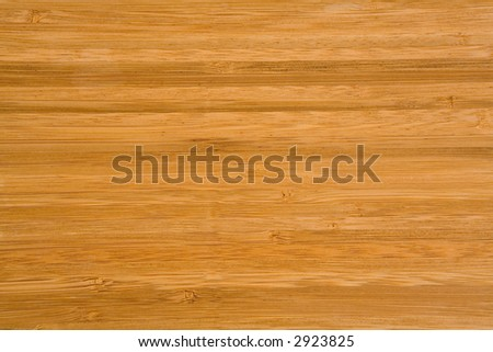 Smooth bamboo wood background board in a horizontal pattern.