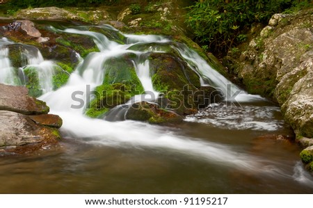 Smooth cascades near Cades Cove at the Great Smoky Mountains National Park. - stock photo
