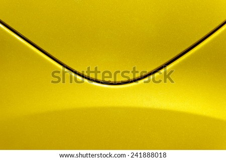 Smooth curves of bright yellow metal car body. Abstract - steel post envelope. - stock photo