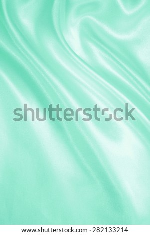 Smooth elegant green silk or satin can use as background