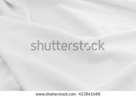 smooth elegant rippled white chiffon fabric background texture can use as wedding background. - stock photo
