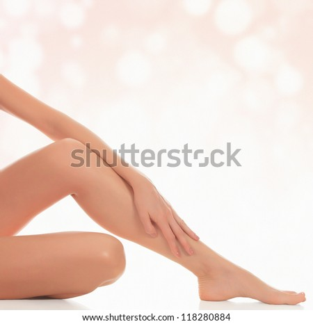 Smooth female legs after depilation, abstract blurred background - stock photo