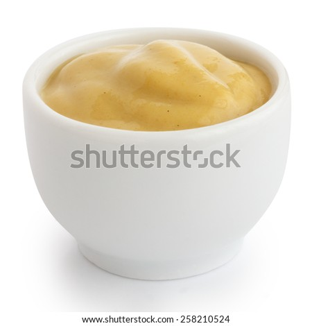 Smooth mustard in white ceramic ramekin. White background. - stock photo