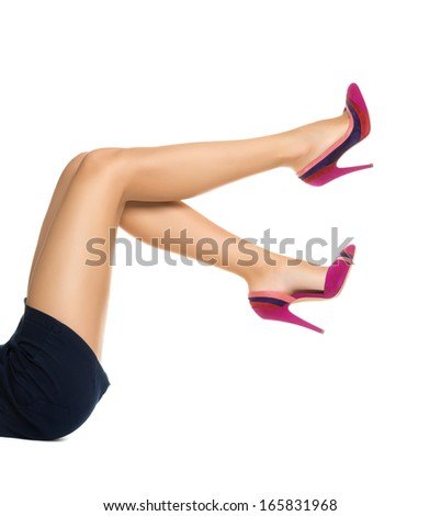 Smooth perfect female legs wearing high heels isolated on white background - stock photo