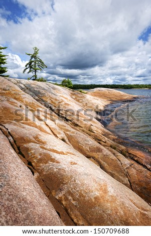 Smooth rocky lake shore of Georgian Bay in Killbear provincial park near Parry Sound, Ontario, Canada. - stock photo