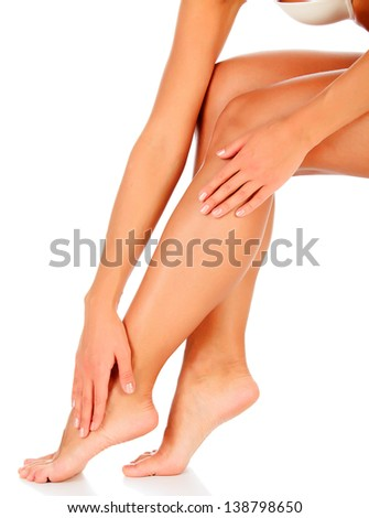 Smooth skin on female legs. White background  - stock photo