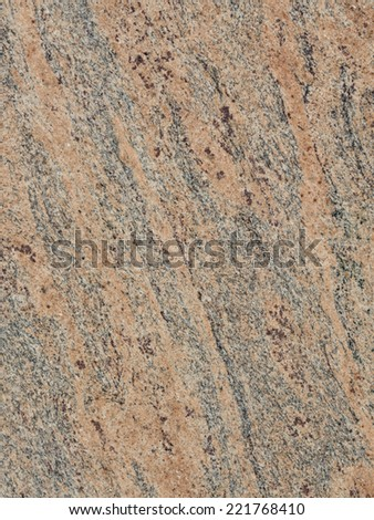smooth solid striped taupe large granite slab  - stock photo