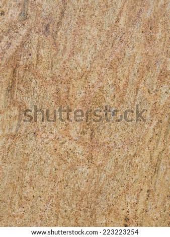 smooth solid striped yellow-brown large granite slab  - stock photo