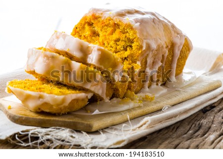Smooth sugar icing spread on top of a tasty loaf - stock photo
