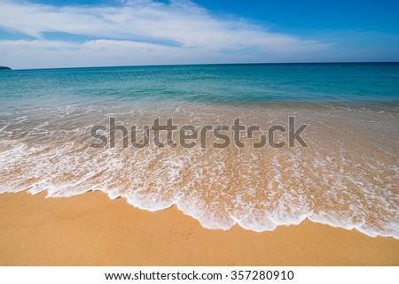 Smooth wave on naiyang beach in sunny day , Phuket - Thailand - stock photo