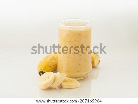 Smoothie banana isolation on white - stock photo