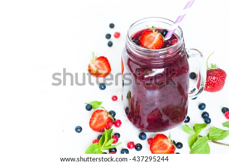 Smoothie. Berry mix smoothie in a mason jar on white background. Healthy drink. - stock photo