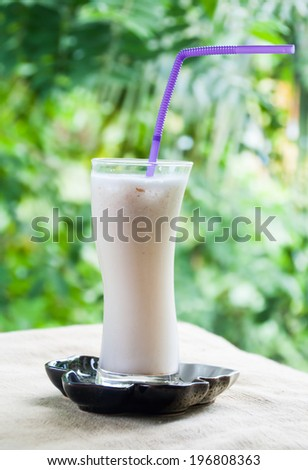 Smoothie coconut white green background