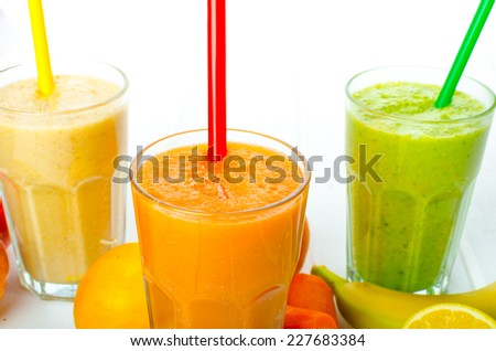 Smoothie Day, time for health - apple-banana, carrot-orange and lemon organic with herbs - stock photo