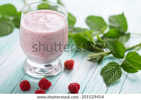 Smoothie drink with raspberry  on aqua background. Selective focus, horizontal. - stock photo