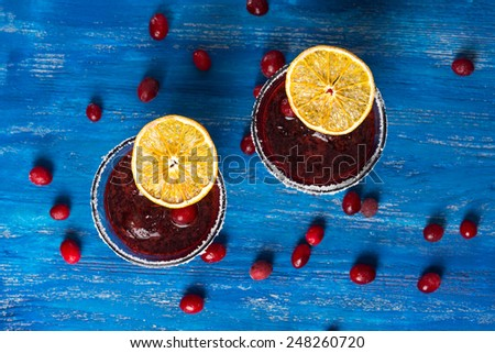 Smoothie - Fresh Berries topped with orange slice - stock photo