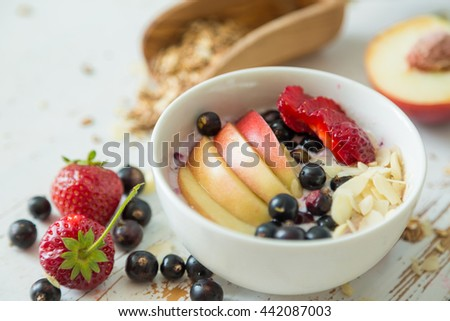Smoothie in a bowl with fruits and seeds