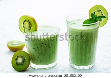 smoothie kiwi in a glass on a white background. tinting. selective focus - stock photo
