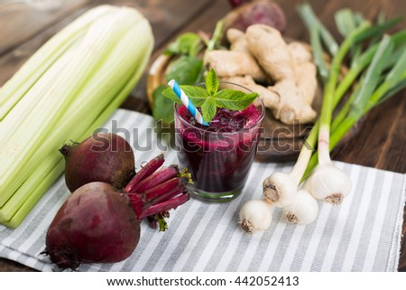Smoothie of beets and fresh vegetables on kitchen table