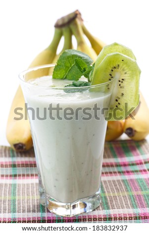 smoothie with kiwi and banana with mint in a glass