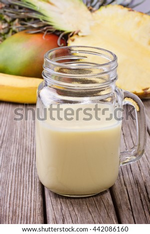 Smoothie with mango, banana, pineapple