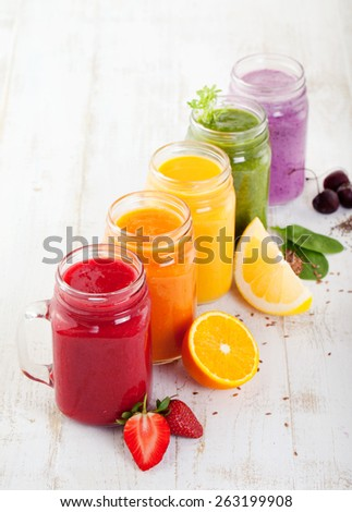 Smoothies, juices, beverages, drinks  variety with fresh fruits and berries on a white wooden background. - stock photo