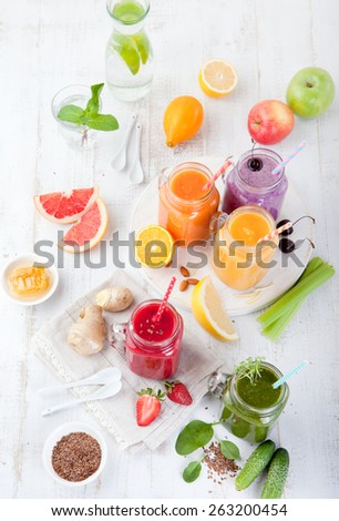 Smoothies, juices, beverages, drinks  variety with fresh fruits and berries on a white wooden background. Top view. - stock photo