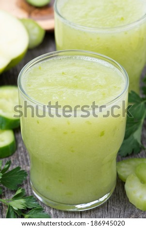 Smoothies of green apple, celery and lime, close-up, vertical - stock photo