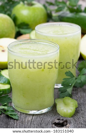 Smoothies of green apple, celery and lime, vertical, close-up - stock photo